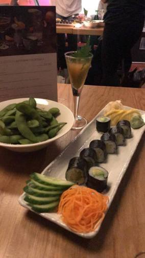Avacado Sushi rolls with beans and cocktail